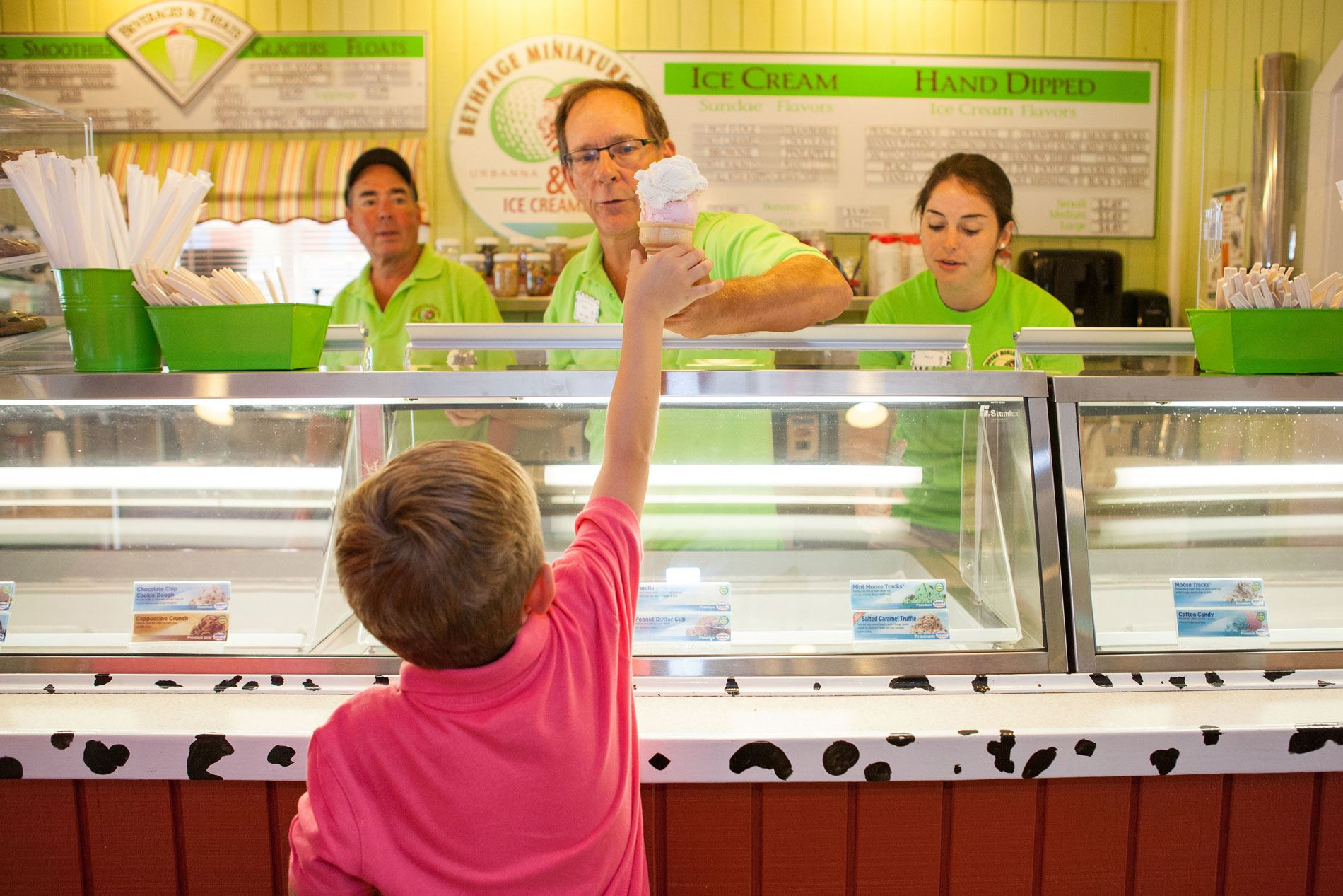 Child receiving an ice cream cone at Bethpage Ice Creamery